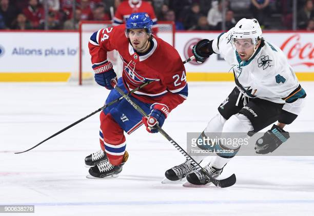 Phillip Danault of the Montreal Canadiens skates against Brenden Dillon of the San Jose Sharks in the NHL game at the Bell Centre on January 2 2018...