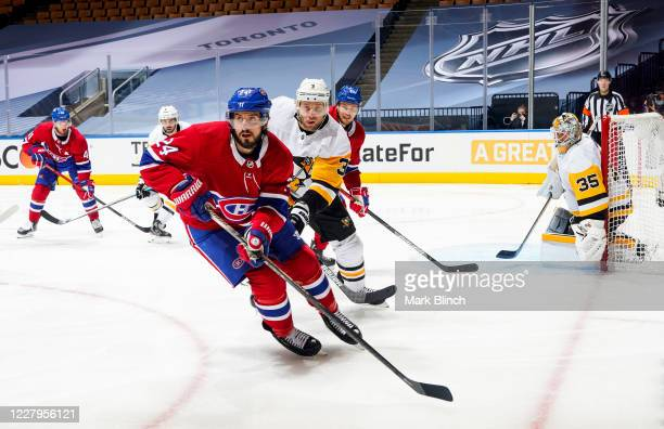 Phillip Danault of the Montreal Canadiens skates against Jack Johnson of the Pittsburgh Penguins during the third period in Game Four of the Eastern...