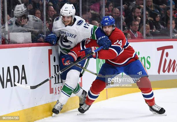 Phillip Danault of the Montreal Canadiens skates against Nic Dowd of the Vancouver Canucks in the NHL game at the Bell Centre on January 7 2018 in...