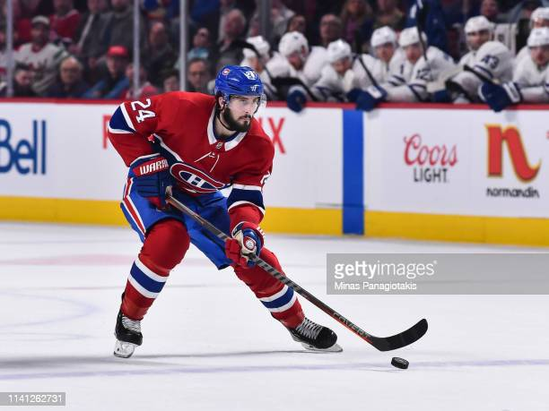 Phillip Danault of the Montreal Canadiens skates the puck against the Toronto Maple Leafs during the NHL game at the Bell Centre on April 6, 2019 in...
