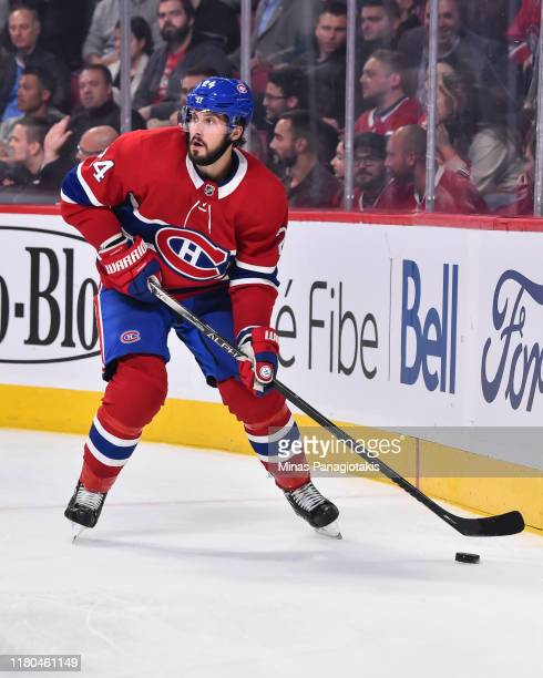 Phillip Danault of the Montreal Canadiens skates the puck against the Detroit Red Wings during the third period at the Bell Centre on October 10,...