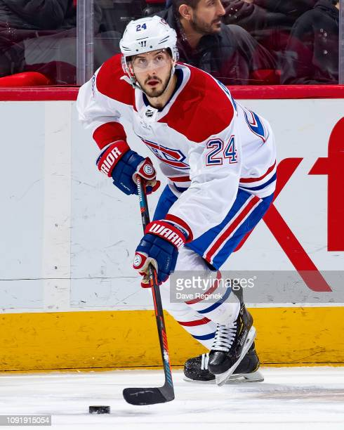 Phillip Danault of the Montreal Canadiens skates up ice with the puck against the Detroit Red Wings during an NHL game at Little Caesars Arena on...