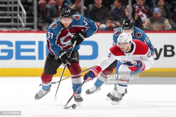 Phillip Danault of the Montreal Canadiens steals the puck from JT Compher of the Colorado Avalanche at the Pepsi Center on December 19 2018 in Denver...