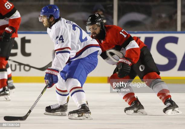 Phillip Danault of the Montreal Canadiens stickhandler the puck while under pressure from Nate Thompson of the Ottawa Senators in the 2017 Scotiabank...
