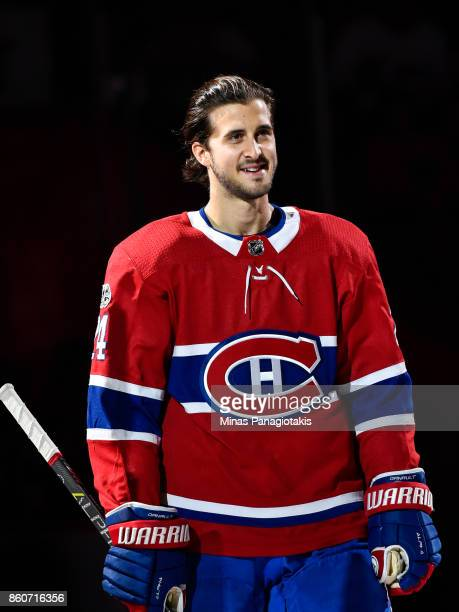 Phillip Danault of the Montreal Canadiens takes to the ice during the pre game ceremony prior to the NHL game against the Chicago Blackhawks at the...