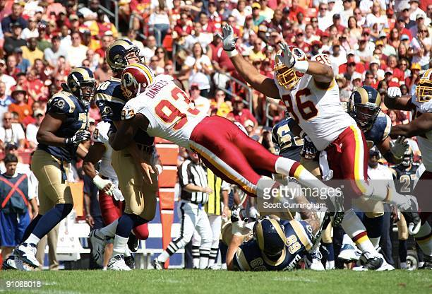 Phillip Daniels of the Washington Redskins pressures Mark Bulger of the St Louis Rams at FedEx Field on September 20 2009 in Landover Maryland