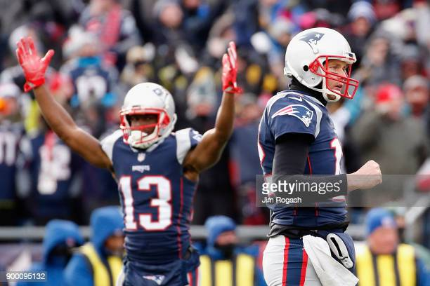 Phillip Dorsett and Tom Brady of the New England Patriots celebrate after a rushing touchdown by Dion Lewis during the first quarter against the New...