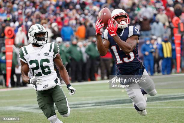 Phillip Dorsett of the New England Patriots attempts to make a reception as he is defended by Marcus Maye of the New York Jets during the first half...