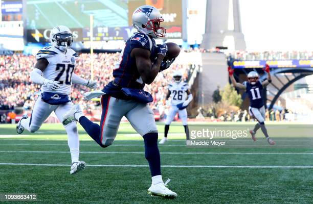 Phillip Dorsett of the New England Patriots catches a touchdown pass during the second quarter in the AFC Divisional Playoff Game against the Los...