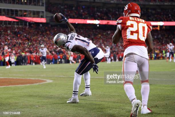 Phillip Dorsett of the New England Patriots celebrates catching a 29 yard touchdown in the second quarter against Steven Nelson of the Kansas City...