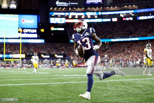 Phillip Dorsett of the New England Patriots runs in the end zone after scoring a 58yard touchdown during the third quarter against the Pittsburgh...