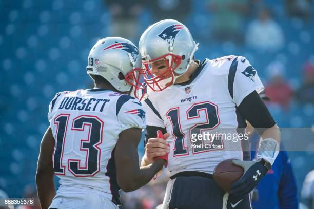 Phillip Dorsett shakes hands with Tom Brady of the New England Patriots before the game against the Buffalo Bills at New Era Field on December 3,...