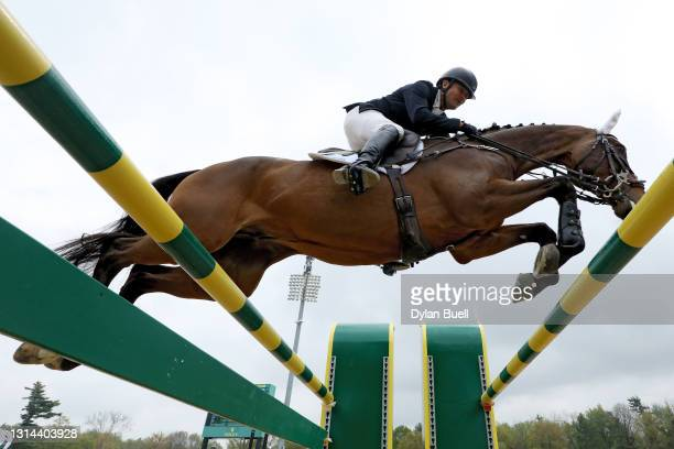 Phillip Dutton atop Fernhill Singapore competes during the Stadium Jumping Phase of the Land Rover Kentucky Three-Day Event at the Kentucky Horse...