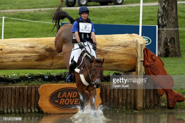 Phillip Dutton atop Fernhill Singapore competes in the Cross Country Phase during the Land Rover Kentucky Three-Day Event at Kentucky Horse Park on...