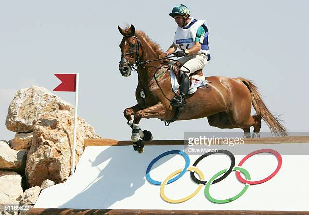 Phillip Dutton of Australia competes on Nova Top in the team three day eventing cross country competition on August 17, 2004 during the Athens 2004...