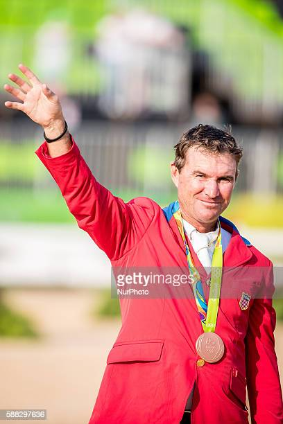 Phillip Dutton of the United States celebrates at the awarding ceremony of the equestrian eventing individual competition at the 2016 Rio Olympic...