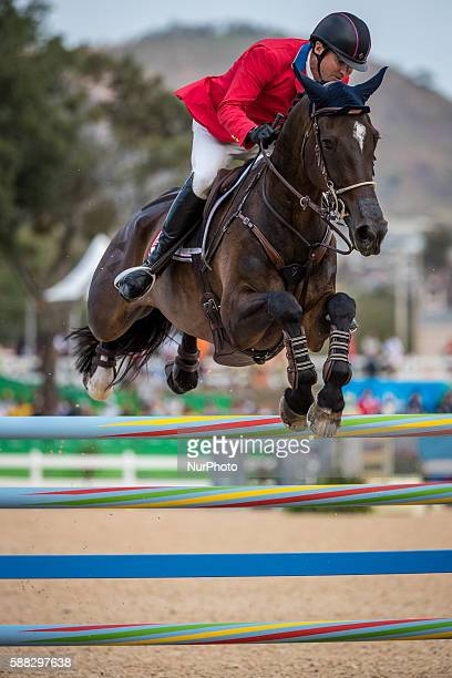 Phillip Dutton of the United States competes during the equestrian eventing individual jumping competition at the 2016 Rio Olympic Games in Rio de...