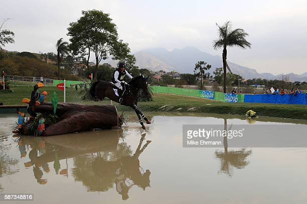 Phillip Dutton of the United States riding Mighty Nice clears a jump during the Cross Country Eventing on Day 3 of the Rio 2016 Olympic Games at the...