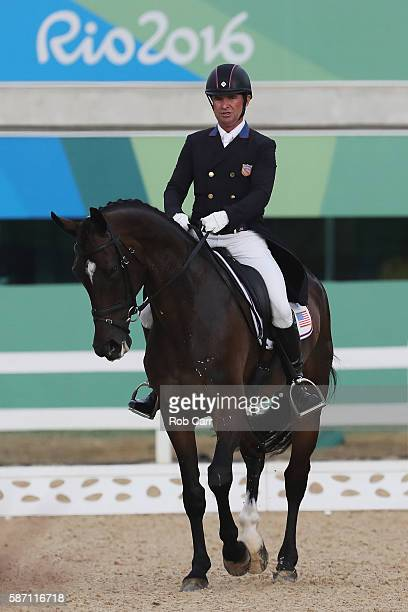 Phillip Dutton of the United States riding Mighty Nice competes in the Eventing Team Dressage event during equestrian on Day 2 of the Rio 2016...