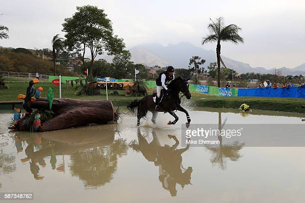 Phillip Dutton of the United States riding Mighty Nice competes during the Cross Country Eventing on Day 3 of the Rio 2016 Olympic Games at the...