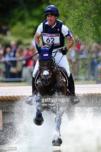 Phillip Dutton of the United States riding Mystery Whisper through a water jump in the Eventing Cross Country Equestrian event on Day 3 of the London...