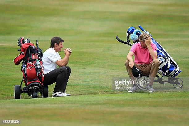 Phillip Edwards of Nottinghamshire Golf Lessons and David Griffiths take a rest during slow play during day two of the Golfbreakscom PGA Fourball...