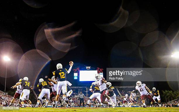 Phillip Ely of the Toledo Rockets drops back to throw during the first half of the game against the Temple Owls at FAU Stadium on December 22 2015 in...