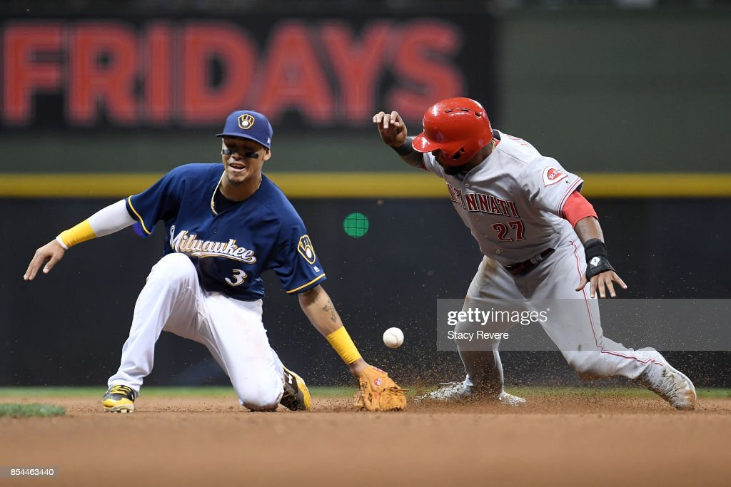 Phillip Ervin #27 of the Cincinnati Reds beats a tag at second base by Orlando Arcia #3 of the Milwaukee Brewers during the ninth inning of a game at Miller Park on September 26, 2017 in Milwaukee, Wisconsin.