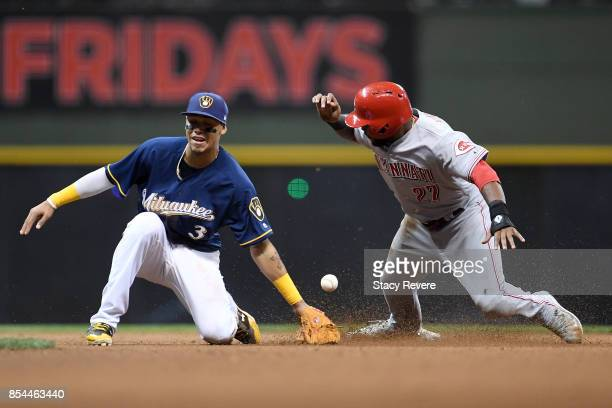 Phillip Ervin of the Cincinnati Reds beats a tag at second base by Orlando Arcia of the Milwaukee Brewers during the ninth inning of a game at Miller...