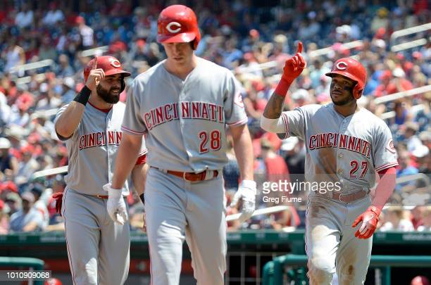 Phillip Ervin of the Cincinnati Reds celebrates after hitting a three-run home run with Anthony DeSclafani and Jose Peraza in the second inning...