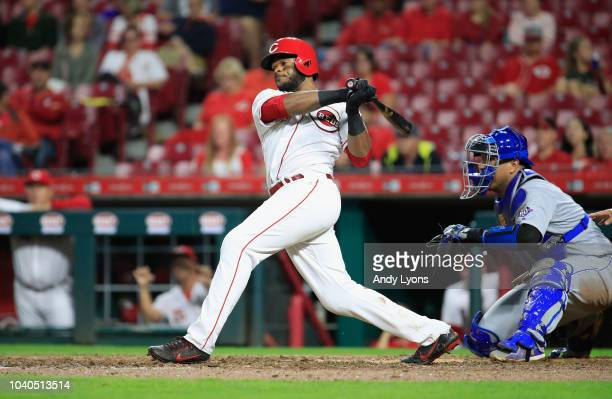 Phillip Ervin of the Cincinnati Reds hits a RBI single in the 7th inning against the Kansas City Royals at Great American Ball Park on September 25...