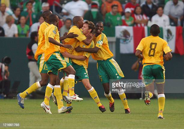 Phillip Evans of South Africa is congratulated by teammates after scoring a first-half goal during 2-1 victory over Mexico in CONCACAF Gold Cup...