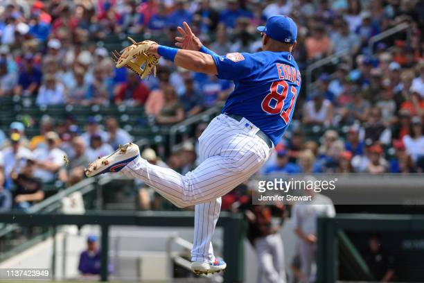 Phillip Evans of the Chicago Cubs throws the ball to first to make an out against the San Francisco Giants during the spring training game at Sloan...