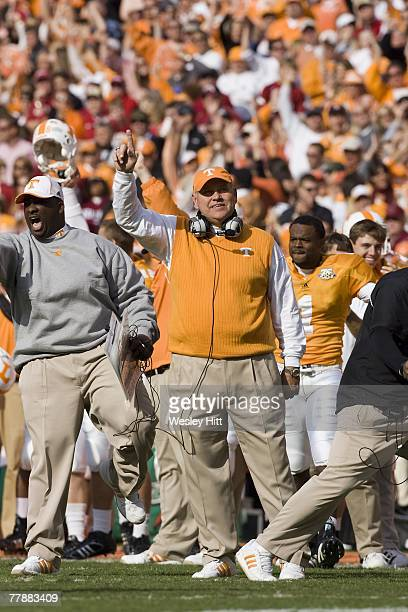 Phillip Fulmer of the Tennessee Volunteers celebrates a touchdown during their game against the Arkansas Razorbacks at Neyland Stadium on November...