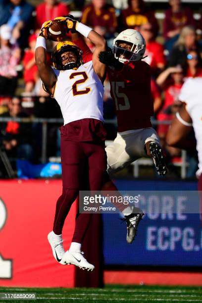 Phillip Howard of the Minnesota Golden Gophers hauls in an interception against Shameen Jones of the Rutgers Scarlet Knights during the second...