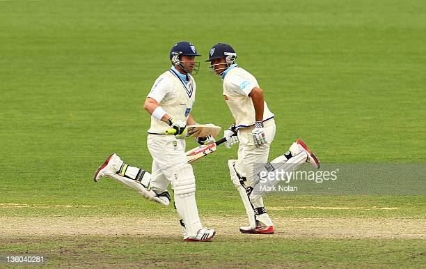 Phillip Hughes and Usman Khawaja of the Chairmans XI run between wickets during day three of the International Tour match between India and the...
