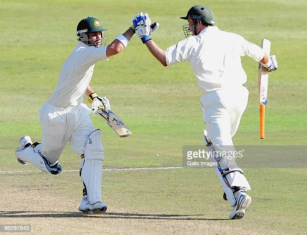 Phillip Hughes celebrates his century with Michael Hussey during day three of the Second Test between South Africa and Australia played at Kingsmead...