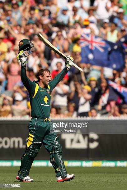 Phillip Hughes of Australia celebrates his century during game one of the Commonwealth Bank One Day International series between Australia and Sri...