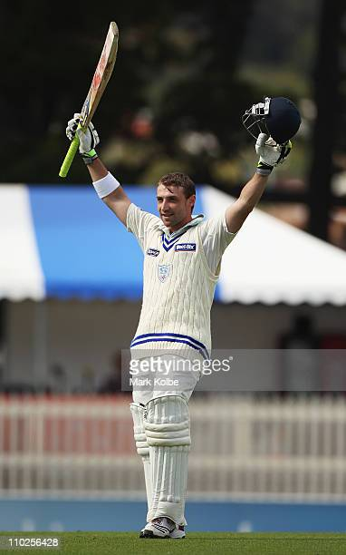 Phillip Hughes of the Blues celebrates his century during day one of the Sheffield Shield final match between the Tasmanian Tigers and the New South...