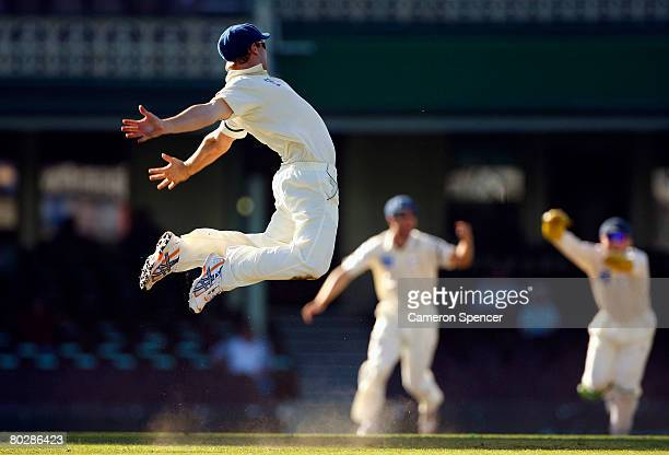 Phillip Hughes of the Blues celebrates taking the catch of Brad Hodge of the Bushrangers off the bowling of Stuart MacGill during day four of the...