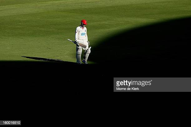 Phillip Hughes of the Redbacks leaves the field after getting out during day two of the Sheffield Shield match between the South Australia Redbacks...