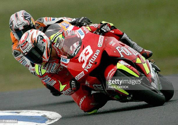 Marco Melandri of Italy leads Dani Pedrosa of Spain during the Australian Motorcycle Grand Prix in Phillip Island 17 September 2006 Melandri riding a...