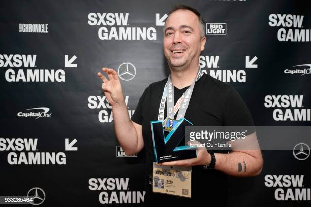 Phillip Johnson poses with an award at SXSW Gaming Awards during SXSW at Hilton Austin Downtown on March 17 2018 in Austin Texas