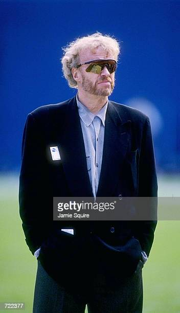 Phillip Knight CEO of Nike watches the San Diego Chargers vs Denver Broncos game at Mile High Stadium November 19 1995 in Denver Colorado The Broncos...