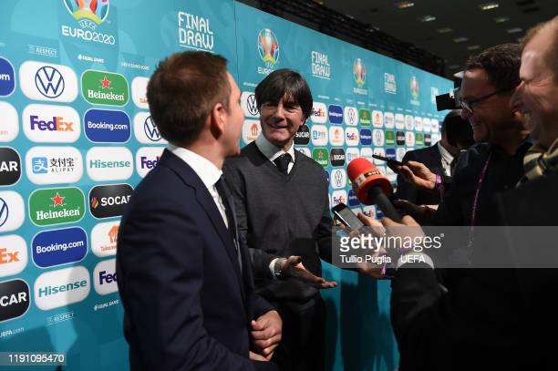 Phillip Lahm and Joachim Low meet press members after the UEFA Euro 2020 Final Draw Ceremony on November 30 2019 in Bucharest Romania