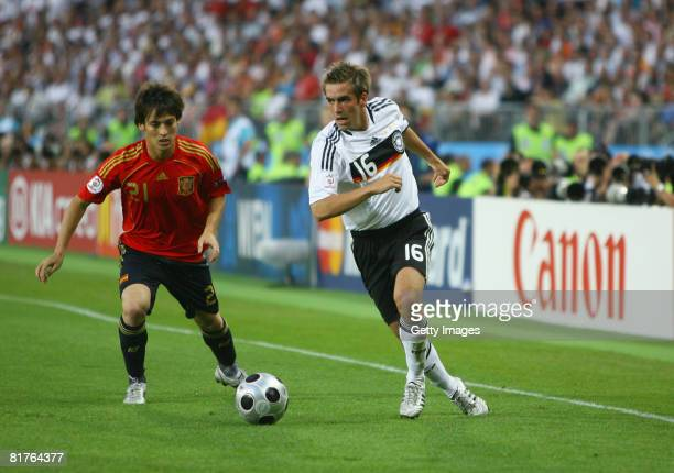 Phillip Lahm of Germany takes on David Silva of Spain during the UEFA EURO 2008 Final match between Germany and Spain at Ernst Happel Stadion on June...