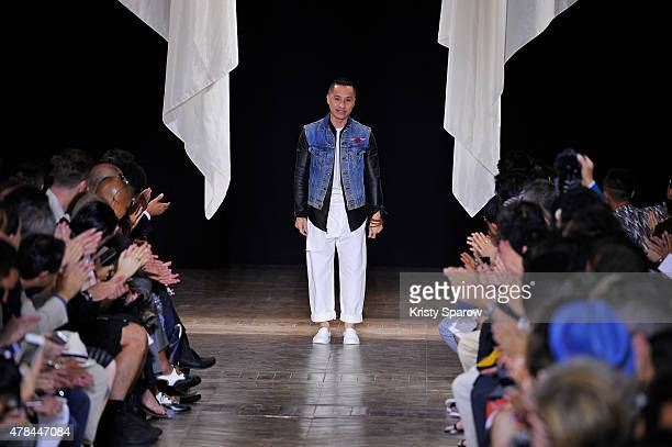 Phillip Lim acknowledges the audience the runway during the 31 Phillip Lim Menswear Spring/Summer 2016 show as part of Paris Fashion Week on June 25...