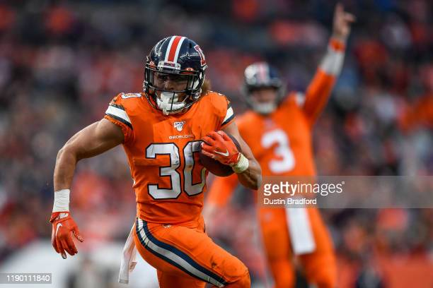 Phillip Lindsay of the Denver Bronco carries the ball against the Detroit Lions in the fourth quarter of a game at Empower Field on December 22, 2019...