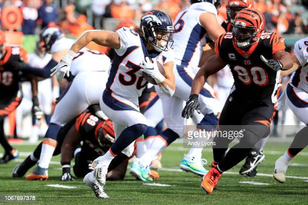 Phillip Lindsay of the Denver Broncos attempts to run the ball past Michael Johnson of the Cincinnati Bengals during the first quarter at Paul Brown...