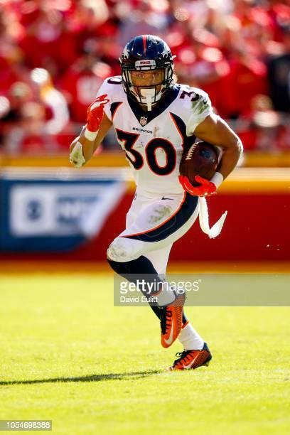 Phillip Lindsay of the Denver Broncos breaks in to the open field during the first half of the game against the Kansas City Chiefs at Arrowhead...